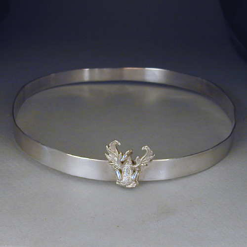 Sterling silver half-inch high circlet crown. Adorned with a Dragon.