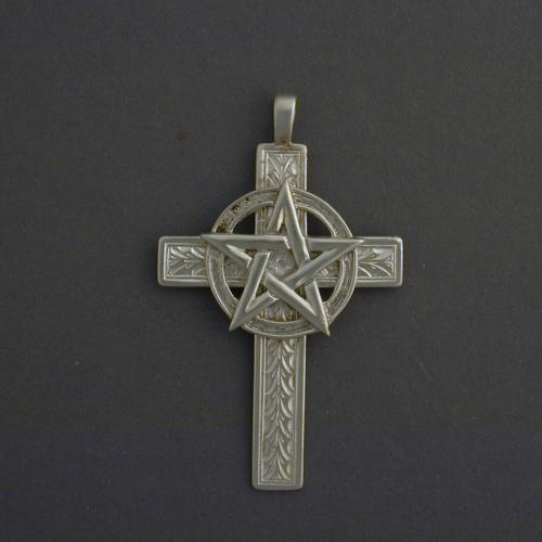 This 1 1/2 inch cross has a discreet foral pattern and a half inch pentagram.