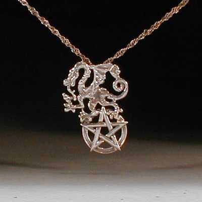 Sterling silver dragon and pentagram pendant.