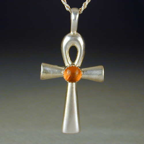 This is a smaller version of our amber set ankh. This piece is also available in other cabochon stones.