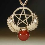 The pentagram has long been associated with protection in many cultures. The knights of the crusades had the star placed on their shields as a protective talisman. Where the symbol of the cross represented the Christ's suffering the pentacle represented his protection. This Sterling silver piece is set with a 12mm round carnelian, a popular stone from ancient Egypt through the middle ages, and the Renaissance. This stone is associated with protection and courage.